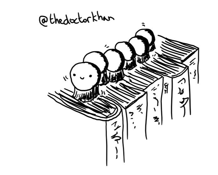 A robot composed of six small spheres, arranged in a row like a caterpillar, with a smiley face on the foremost one. Instead of legs it has a little round brush on the bottom of each sphere and is making its way along a row of books.