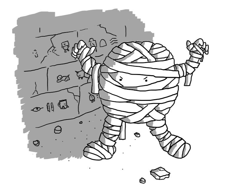 A round robot wrapped in bandages like an Egyptian mummy, lurching forward with its arms raised menacingly. Behind it is a stone wall marked with ancient Egyptian hieroglyphics that also include images of Teabot, Notokaybot, Unicornbot and Spiderbot.