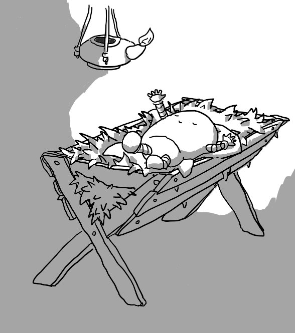 A small, round-topped robot with banded arms and legs sleeps peacefully on a wooden manger filled with straw. It's kicking out with one leg and reaching up towards a clay lamp hanging over it that casts light around the robot.
