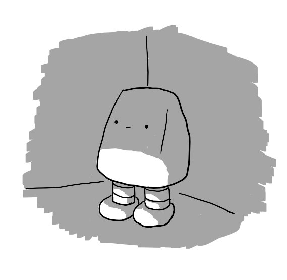 A wedge-shaped robot on two banded legs with no arms and a blank expression on its face stands in a darkened corner of a room.